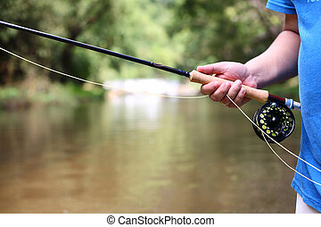 fly fishing rod in hand
