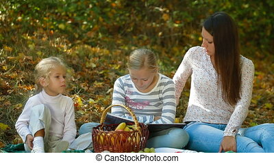 Mother And Children At Picnic