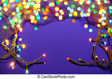Christmas lights on dark blue background with copy space. Decorative garland