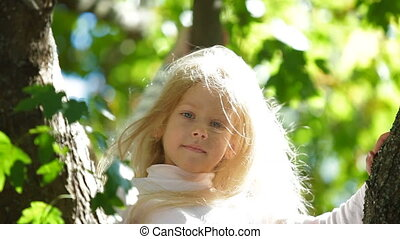 Two Blonde Little Girls On a Tree