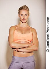 Confident Woman in Her Gym Outfit - Portrait of a confident...