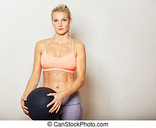 Woman Holding Exercise Ball - Portrait of a fitness woman...