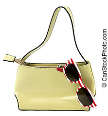 Sunglasses and purse - Purse with striped sunglasses on...
