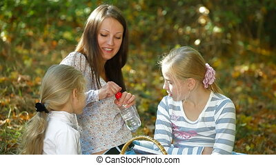 Family Spending Time Together - Young mother and two...