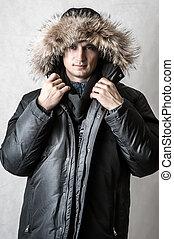 man in black fur hood winter jacket