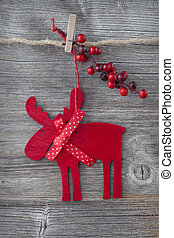 Wooden christmas deer on wooden background