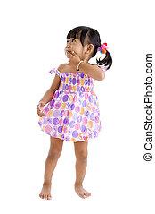 little asian looking sideways