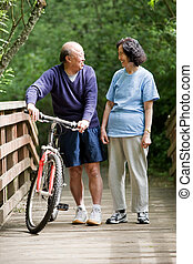 Mature asian exercise - A shot of a couple asian mature...