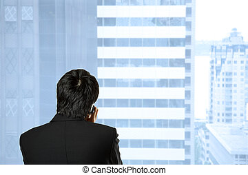 Businessman on the phone - A shot of a businessman talking...