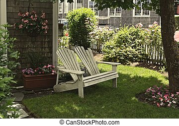 Resting Place - Pair of adirondack chairs on a lush green...