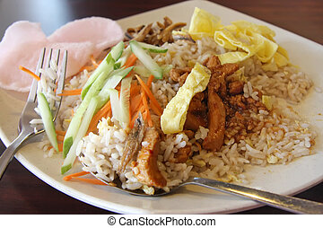 Fried rice with chicken and anchovies traditional malaysian...