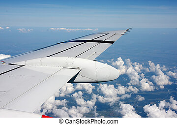 Aerial view from airplane with wing and panoramic landscape