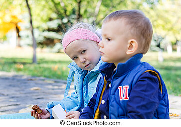 A boy and a girl in the park