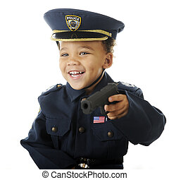 Happy Playing Cop - Closeup image of a delighted preschooler...