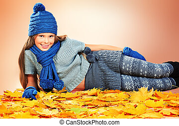 warm clothing - Portrait of a cute girl in autumn clothes...