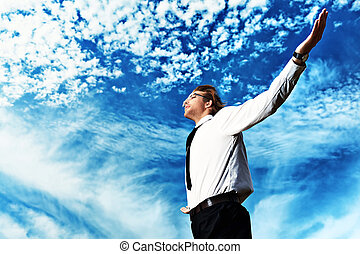 feel free - Successful business man standing over blue sky...