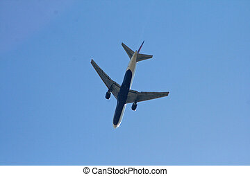 Descending Airplane - Commercial airliner descending out of...