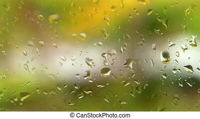 Window raindrops - Focused raindrops on a window pane with...