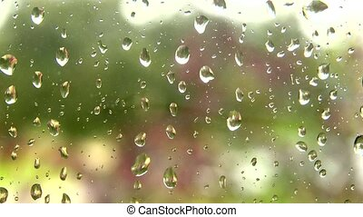 rain on the window - Focused raindrops on a window pane with...