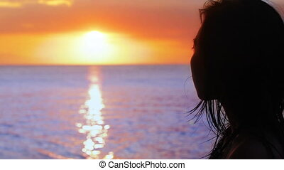 silhouette girl is watching sunset