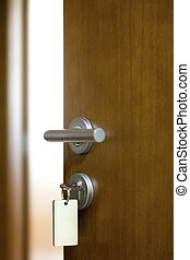 Door unlock with keys macro shot - Real estate concept