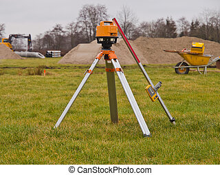 Theodolite and other equipment on a construction site