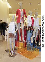 Fashion mannequins in shop window