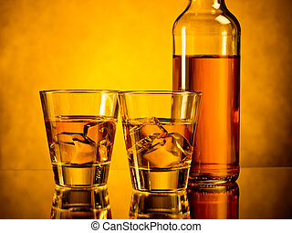 Two drinks - Bottle of whiskey and two glasses