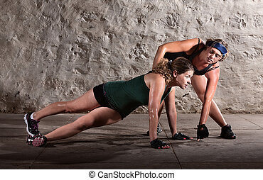 Trainer Helping with Push Ups - Physical fitness trainer...