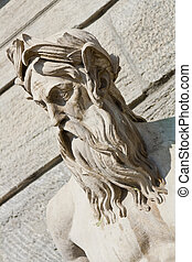 Beard god statue portrait - An ancient statue of the face of...