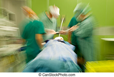 Hospital blurred doctors busy surgery - Blurred figures of...