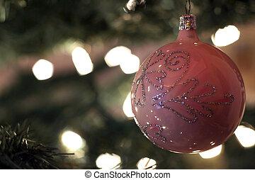 Pink Christmas Ball - An ornate pink Christmas ball hanging...