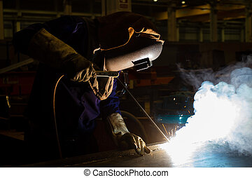 Electric welder welding metal
