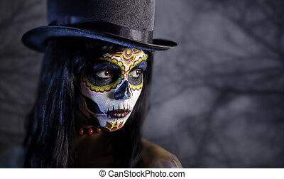 Sugar skull girl in tophat in the forest, Halloween theme