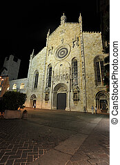 Medieval Como cathedral in night on Lake of Como in...