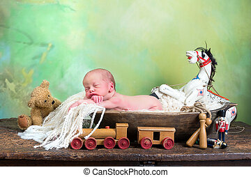 Vintage toys and little baby - Little baby sleeping in a...