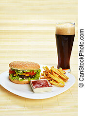 Fast food tasty hamburger with french fries and cola