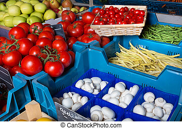 Greengrocer closeup - Closeup on fresh vegetable display at...
