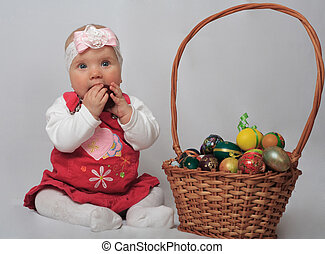 little girl with basket and Easter eggs