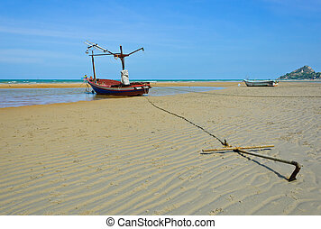 Fishing boat anchored on beach