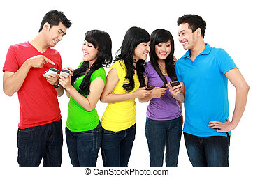 young teenager using handphone - Group of Teenage Friends...