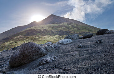 Volcanic island of Stromboli - Black sand beach and stone...