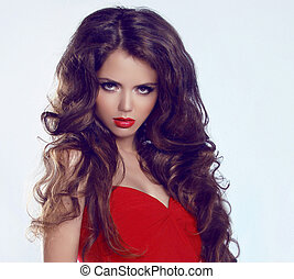 Woman with beauty long brown hair and red lips, posing at...