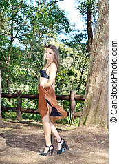 Sexy lady in the park - Attractive and sexy lady alone in...