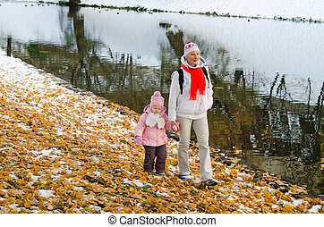grandmother with the grand daughter in autumn park