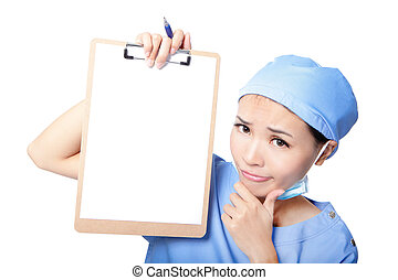 woman nurse thinking showing clipboard - Young woman doctor...