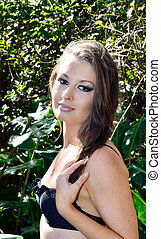 Beauty and the bush - Attractive young brunette lady in...