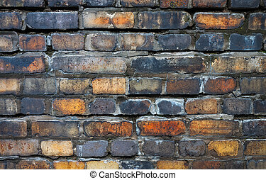 Bricks in the Wall - Weather-beaten bricks show their age as...