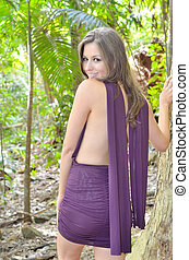 Purple and green - Attractive lady in a purple dress with...