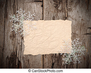Christmas background. blank old paper sheet with snowflakes